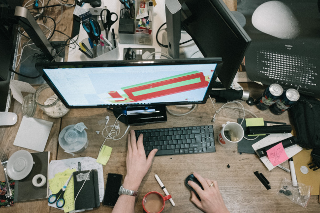 messy desk of outsourced creativity