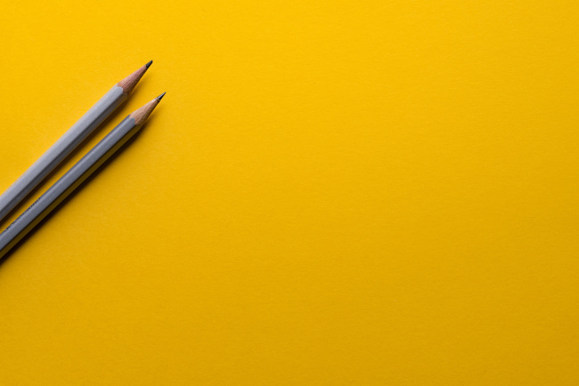 grey pencils on yellow for outsourced creativity