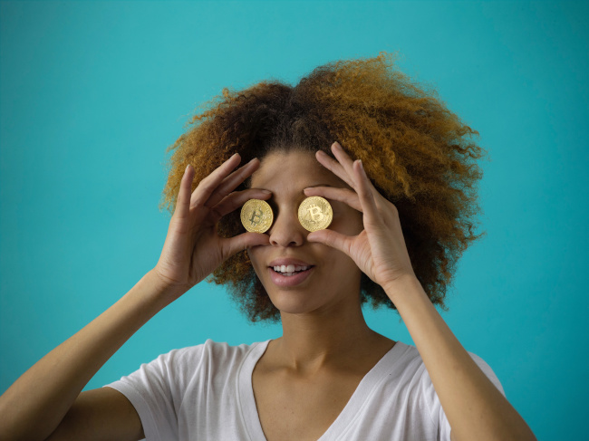 woman with coins for eyes denoting cost of outsourced creativity